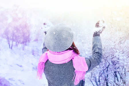Woman enjoys the snow on the winter forest Stock Photo