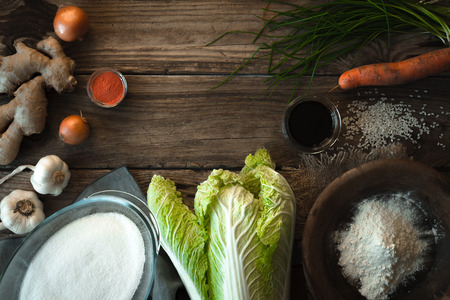Frame with Chinese cabbage and ingredients for kimchi on a wooden table horizontal Stock Photo