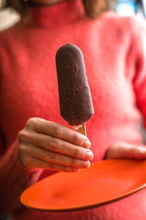 Eskimo ice cream in the woman`s hand