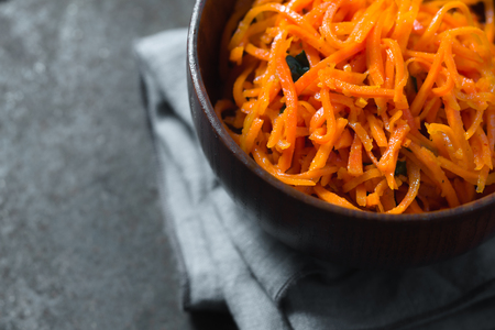 korean salad: Carrots in Korean with spices on a metal table partial blur