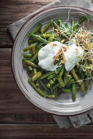 sprouted: Salad with beans, sprouted flax and quail eggs top view Stock Photo