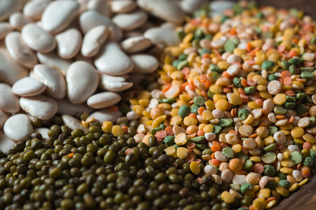 Placer green and white beans, lentils close up