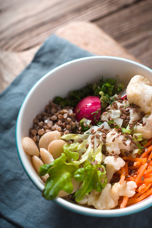Vegetable salad with buckwheat in a ceramic bowl Stock Photo