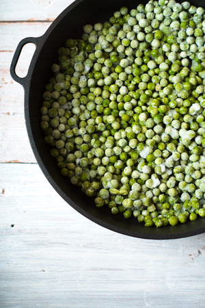 black gram: Green beans mung beans in a saucepan on white boards Stock Photo