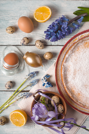 German Easter cake, eggs, flowers, ribbons on the table top view Stock Photo