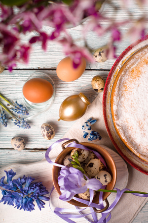 German Easter cake, eggs, flowers, ribbons on the table closeup Stock Photo