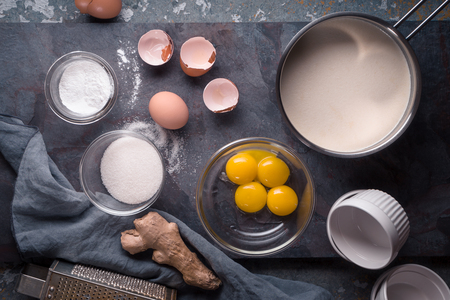 metal grater: Eggs, sugar , cream , sugar and ginger on stone