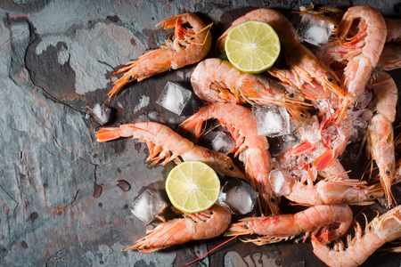 icecubes: Prawns with lemon and ice cube on the stone