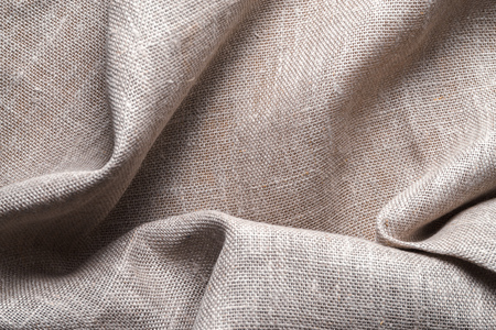 Background of linen napkin folded in folds Stock Photo