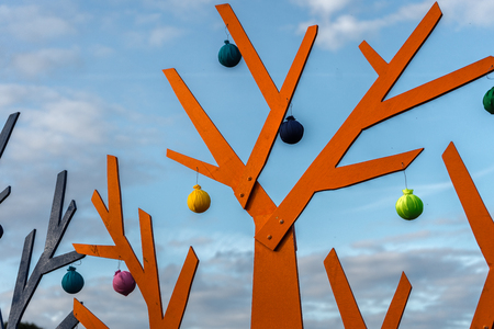 Abstract orange tree on a background of blue sky
