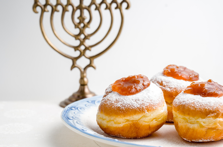 Hanukkah Minor, donuts with jam on a plate on a white background