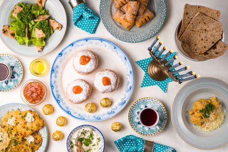 Jewish holiday Hanukkah, traditional feast view from above Stock Photo