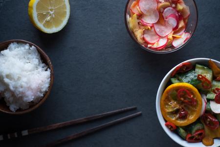 Rice, pickled vegetables, lemon and chopsticks free space. Asian cuisine