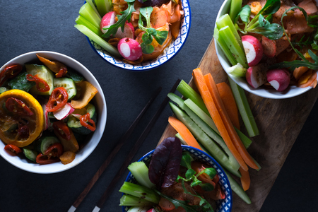 Marinated vegetables in bowls and chopsticks close-up. Asian cuisine Stock Photo