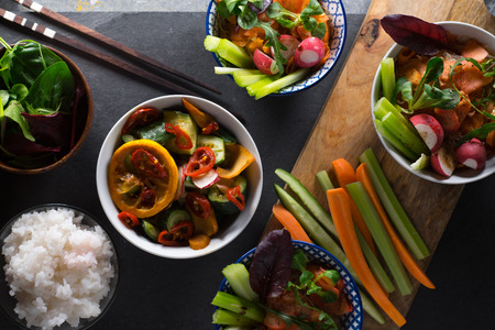 Rice, pickled vegetables in bowls and chopsticks close-up. Asian cuisine 스톡 콘텐츠