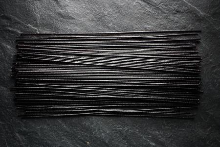 Black dry rice noodles on black stone