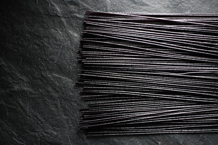 Black dry rice noodles on black stone free space Stock Photo