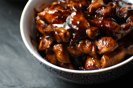 Finished pieces of chicken breast in teriyaki sauce. Asian cuisine