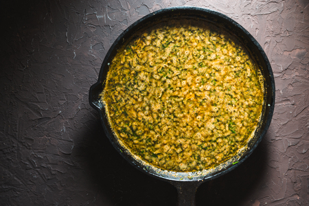 Yellow curry paste on a cast-iron frying pan. Indian food Stok Fotoğraf