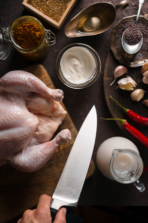 Ingredients for cooking chicken curry on the table. Indian food Stock Photo