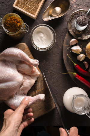 Ingredients for cooking chicken curry on the table closeup. Indian food Stock Photo