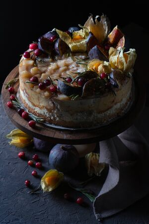 Cheesecake with fruit on a holder and with a napkin