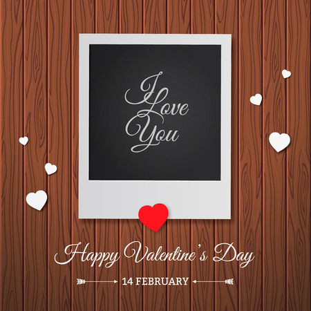 Postcard Happy Valentines Day with a blank template for photo. Photo frame on a wood background.