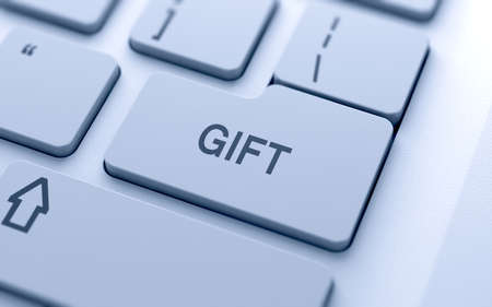 Gift button on keyboard with soft focus  photo