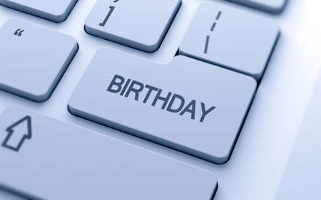 Birthday text button on keyboard with soft focus  photo
