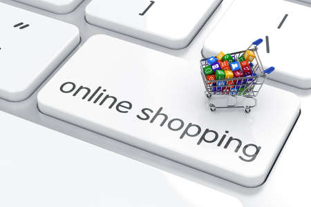 web shop: Shopping cart isolated on the computer keyboard. Online shopping concept