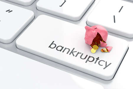 Broken piggy bank on the computer keyboard. Crisis concept  photo