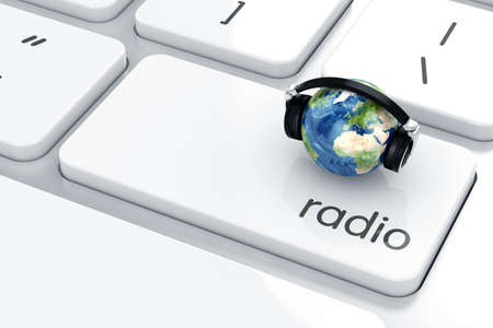 3d render ofheadphones witn Earth icon on the keyboard. Radio concept  photo