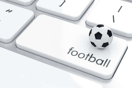Soccer ball on the computer keyboard. Soccer concept  photo