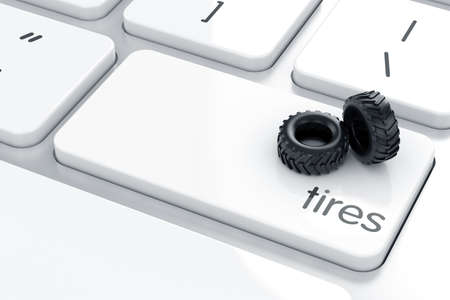 Tires on the computer keyboard. Transportation concept  photo