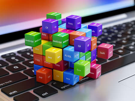 Programming concept. Different machine code languages colorful boxes on the laptop computer keyboard Stock Photo