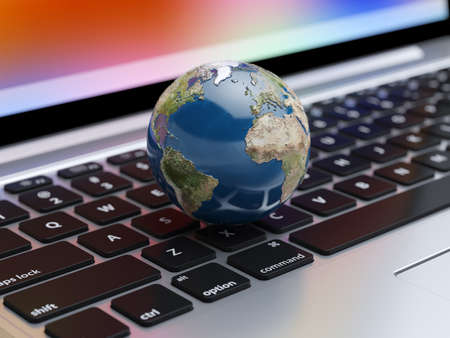 global communication: 3d renderiong of Earth planet on the laptop keyboard. Global communication concept.