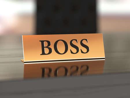 Gouden naamplaatje met Boss tekst op de houten tafel, met soft focus