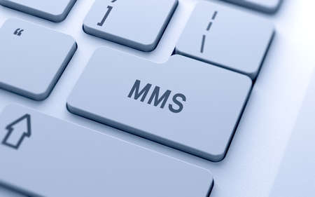 marketing concept: MMS word button on computer keyboard with soft focus