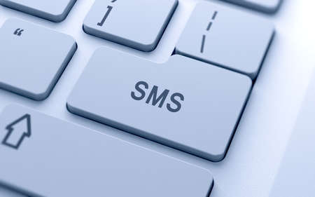 computer button: SMS word button on computer keyboard with soft focus