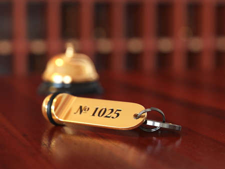 3d rende of hotel room key with golden lable room number on the wooden table. Soft focus illustration