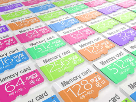 gigabyte: Group of colorful memory micro sd cards on white background. Storage and mobility transfer concept Stock Photo