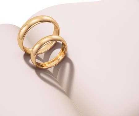 anillos boda: Los anillos de boda proyección de sombras en forma de corazón sobre un libro en blanco
