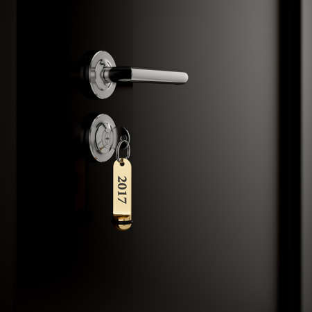 lock concept: Brown hotel room door with key in the lock with golden lable number 2017 new year concept Stock Photo