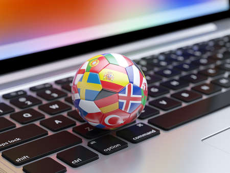 3d rendering of a soccer ball with flags icons from the Europe countries on the computer laptop keyboard