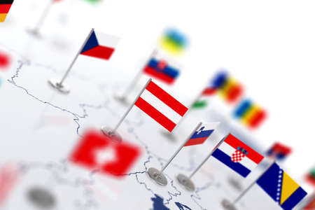 shallow: Austria flag in the focus. Europe map with countries flags. Shallow depth of field 3d illustration rendering isolated on white background Stock Photo