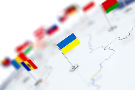 Ukraine flag in the focus. Europe map with countries flags. Shallow depth of field 3d illustration rendering isolated on white background Stock Photo