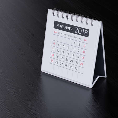 event planner: Modern flat design desk calendar for november 2018 year on black wood table background. 3d rendering illustration