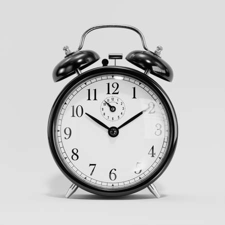 Klasyczny czarny zegar stołowy na białym tle