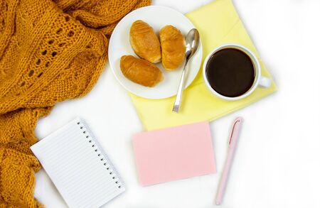 Breakfast in bed. Flat composition with coffee, croissants and a notebook for writing. Lifestyle concept frame. Top view on sheets Фото со стока - 130998139