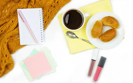 Breakfast in bed. Flat composition with coffee, croissants and a notebook for writing. Lifestyle concept frame. Top view on sheets Фото со стока - 130998151